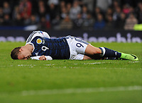 Football - 2016 / 2017 World Cup Qualifier - UEFA Group F: Scotland vs. Slovenia<br /> <br /> Leigh Griffiths of Scotland lies injured after a knee in the back from Jan Oblak of Slovenia during the match at Hampden Park.<br /> <br /> COLORSPORT