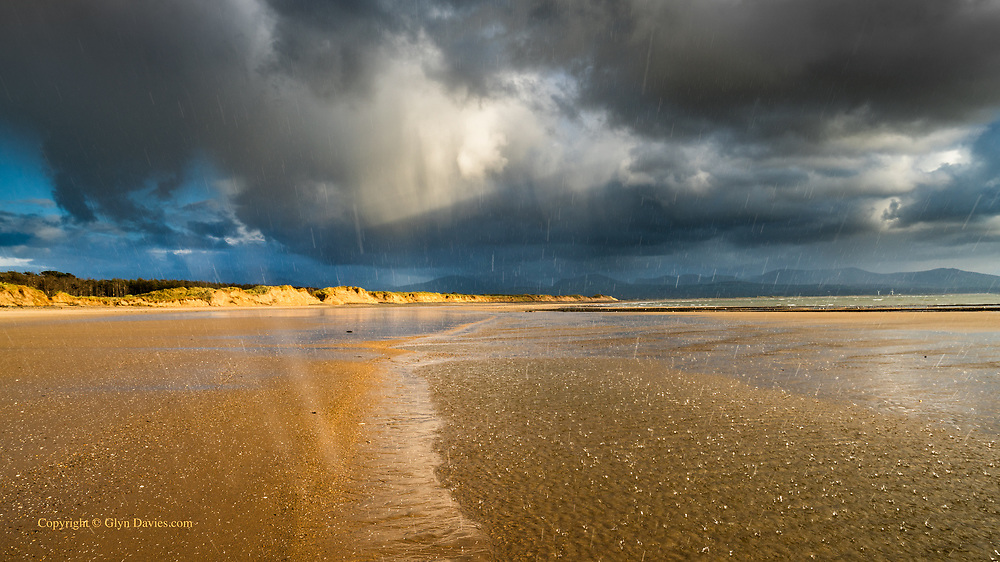 I just stood there back to the gale as the Heaven's opened and pummelled me with freezing hail. Throughout the squall the sunshine continued, blasting the miles-long sand dunes in Autumnal light. I had to shoot quickly, and hid the camera in my jacket. Stunning lighting and a beach almost to myself - immersed in the elements - perfection.