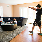 Spencer celebrates the end of his 30 minute workout that he had to record and upload for his virtual Physical Education class. Erin worked from the couch after suffering a painful pinched-nerve overnight.
