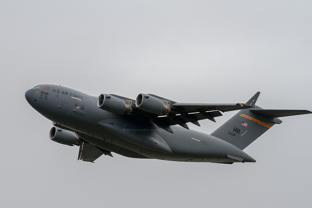 Boeing C17A Globemaster III with the 15th Wing of the US Airforce and 154th Wing of the Hawaii Air National Guard taking off from Naval Air Facility, Atsugi airbase, Yamato, Kanagawa, japan. Thursday November 12th 2020