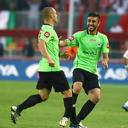 Konyaspor's Erdal KILICASLAN (L) celebrate his goal during their Play Off Second leg match at AliSamiYen Stadium in Istanbul Turkey on Thursday, 20 May 2010. Photo by TURKPIX