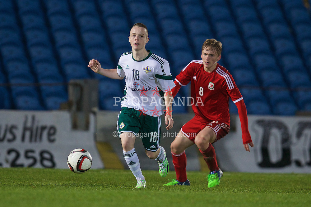 BALLYMENA, NORTHERN IRELAND - Thursday, November 20, 2014: Wales' Matty Smith in action against Northern Ireland's Reece McGinley during the Under-16's Victory Shield International match at the Ballymena Showgrounds. (Pic by David Rawcliffe/Propaganda)