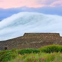 Cahergal Ring fort at Sunrise near Cahersiveen, County Kerry, Southwest ireland with fog flowing over the mountains / ch229