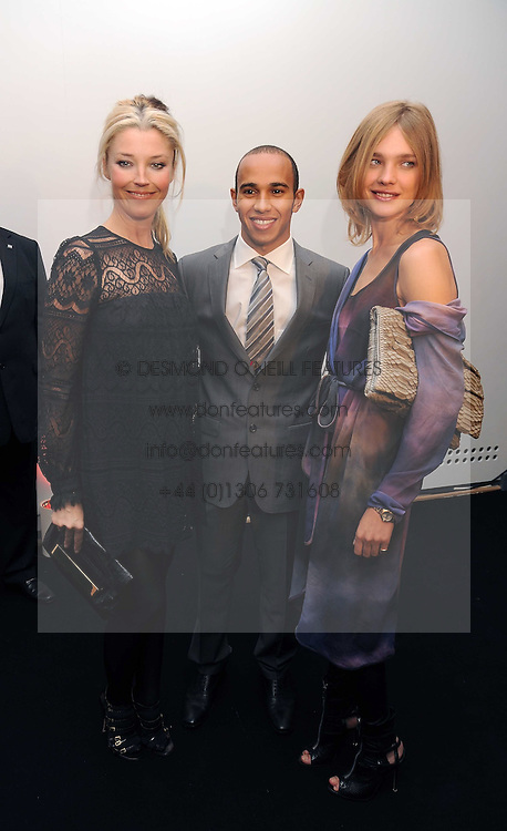 Left to right, TAMARA BECKWITH, LEWIS HAMILTON and NATALIA VODIANOVA at the TAG Heuer British Formula 1 Party at the Mall Galleries, London on 15th September 2008.