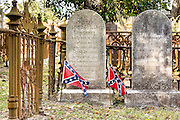 Confederate flags mark the tombstone of Alfred Pickney in historic Magnolia Cemetery in Charleston, South Carolina.