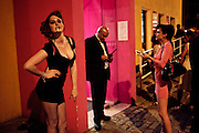 ESME BIANCO; SANDRA GASOLINA, ( VALERIA DRAGOVA) BURLESQUE DANCERS OUTSIDE HOUSE OF BLUEEYES ? show  in the Undercover exhibition. Fashion and Textile Museum, Bermondsey Street<br /> London. 25 July 2009<br /> ESME BIANCO; SANDRA GASOLINA, ( VALERIA DRAGOVA) BURLESQUE DANCERS OUTSIDE HOUSE OF BLUEEYES Ð show  in the Undercover exhibition. Fashion and Textile Museum, Bermondsey Street<br /> London. 25 July 2009