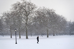 © Licensed to London News Pictures. 28/02/2018. London, UK. A man walks through picturesque scenes Primrose Hill, West London following heavy snowfall last night. Large parts of the UK are experiencing disruption as 'Storm Emma' hits, following Russian a cold front earlier in the week named 'The Beast From The East'. Photo credit: Ben Cawthra/LNP