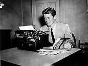 """JFK Diary up for Auction<br /> <br /> After the end of the war in 1945, Ambassador Joseph Kennedy arranged for his 28-year-old son, Jack, to work for Hearst newspapers. This allowed the young veteran to attend the opening session of the United Nations in San Francisco in May and then travel abroad to cover post-war Europe during the Summer of 1945. <br /> <br /> JFK followed Prime Minister Churchill throughout England during his reelection campaign. He traveled to Ireland, France, then to the Potsdam Conference in Germany with Navy Secretary James Forrestal. He even viewed the charred remains of Hitler's bombed out bunker in Berlin and observed the Fuhrer's famed Berchtesgaden 'Eagle's Nest.'<br /> <br /> John F. Kennedy recorded his historic trip in a 61-page diary, documenting his personal observations of what he saw firsthand and perceptions of what would happen in the post-war world. This incredible manuscript reveals his insightful views and predictions of the world around him at an early age—a man who would, sixteen years later, become America's 35th President.<br /> <br /> Comprised of 61 loose-leaf pages, 12 handwritten and 49 typed, the diary is housed in a quality Trussell cowhide leather binder. <br /> <br /> Photo shows: John F. Kennedy at a typewriter with his book """"Why England Slept.""""  Please credit """"John F. Kennedy Presidential Library and Museum, Boston""""<br /> ©rrauction/Exclusivepix Media"""