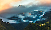 High mountain peak rounded of red clouds