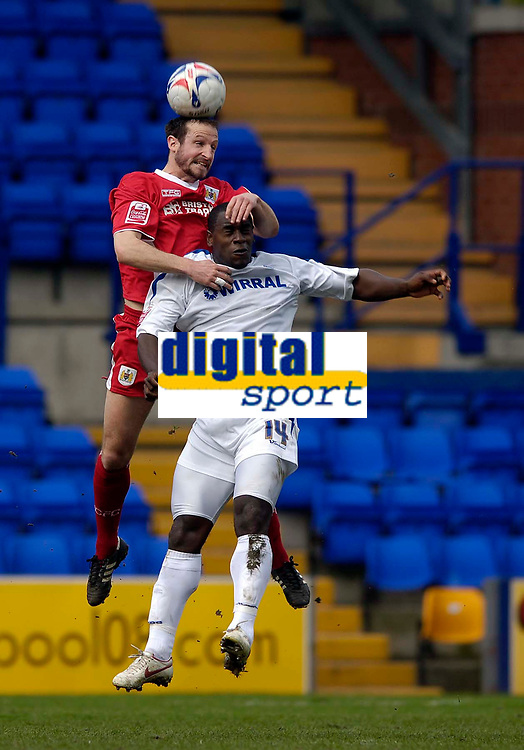 Photo: Jed Wee.<br />Tranmere Rovers v Bristol City. Coca Cola League 1. 22/04/2006.<br /><br />Bristol City's Louis Carey (L) jumps above Tranmere's Delroy Facey to win the ball.