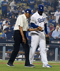 October 6, 2017 - Los Angeles, California, U.S. - Los Angeles Dodgers relief pitcher Kenley Jansen walks with former Brooklyn Dodger Don Newcombe before throwing out the ceremonial pitch prior to a National League Divisional Series baseball game against the Arizona Diamondbacks at Dodger Stadium on Friday, Oct. 06, 2017 in Los Angeles. (Photo by Keith Birmingham, Pasadena Star-News/SCNG) (Credit Image: © San Gabriel Valley Tribune via ZUMA Wire)