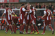 Matt Richards of Cheltenham (centre) celebrates with his teammates after scoring his side's match winning goal .Skybet football league two match, Cheltenham Town v Torquay Utd at the Abbey Business stadium, Whaddon Rd in Cheltenham on Saturday 15th March 2014.<br /> pic by Mark Hawkins, Andrew Orchard sports photography.