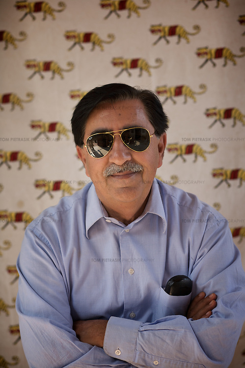 R.N. Mehrotra, Chief Wildlife officer for Rajasthan, in the senior government guesthouse of Jogi Mahal, on the third and final day of an aborted attempt at tiger relocation from Rantambore to Sariska national parks. ..Sariska National Park in Rajasthan was once home to dozens of tigers but by 2005 poaching had resulted in their complete eradication. Recognising the urgent need for intervention, the Indian and Rajasthan-state governments began the reintroduction of tigers into Sariska. Two cats were airlifted 200 km from Ranthambore National Park in June 2008. On November 5th an attempt to relocate a third tiger was postponed until later in the month. This relocation strategy is certainly an important part of the tiger conservation effort but many, including those like Dharmendra Khandal of the NGO Tiger Watch, argue that it will never be entirely successful without properly confronting the three essential issues that threaten tiger populations: poaching, habitat loss and the hunting of prey-base animals. In turn, these three issues cannot be addressed without acknowledging the malign influence of caste, poverty and poor administrative accountability. Poaching is almost exclusively undertaken by extremely poor and marginalised groups, including the Mogia caste who, without education, land and access to credit have limited alternative means of income. Many in the Mogia community also hunt bush meat for both their own consumption and to sell to others. This results in a depletion of the prey-base upon which tigers feed. Encroachment and grazing by those including the Gujar people who raise dairy herds, have led to habitat loss in Sariska and other parks. To properly tackle the problem of hunting and encroachment, the government must provide alternative livelihoods for marginalised groups and relocate them to viable land before - rather than after - the re-introduction of tigers. Compounding all these issues is the ridged hierarchy of India's forest department which dis