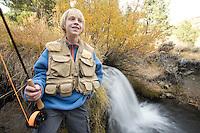 Portrait of young boy fly fishing near Reno, NV