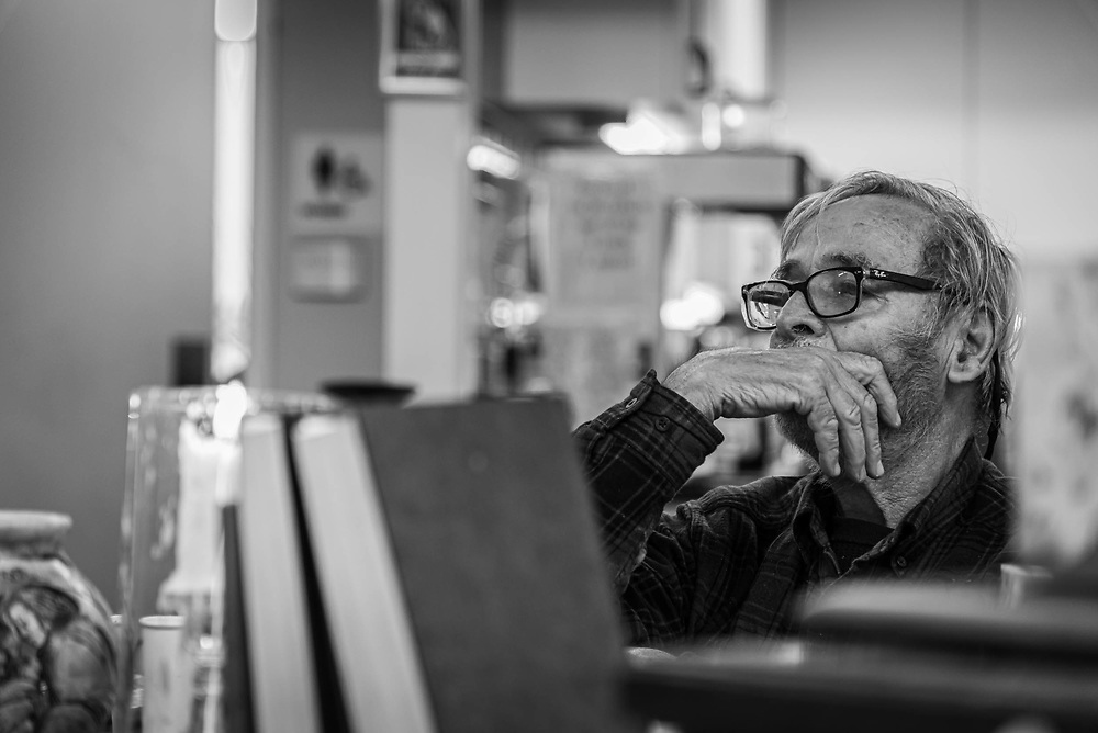 Fairfax, Virginia. March 12th 2019 -Gene Broyhill, 78 waits at the table for the bible studies. Gene was visiting the lamb center past couple of years. He has been homless for 2 years and was able to find housing throgh the help of the lamb center. He visits the lamb ceter regularly for bible studies and for lunch.