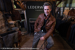 Heiko Wittek in his display with all his leather work in Hall 10 with its all custom focus at the Intermot Motorcycle Trade Fair. Cologne, Germany. Thursday October 6, 2016. Photography ©2016 Michael Lichter.