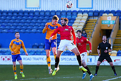 George Maris of Mansfield Town heads the ball away from Aaron Wildig of Morecambe - Mandatory by-line: Ryan Crockett/JMP - 27/02/2021 - FOOTBALL - One Call Stadium - Mansfield, England - Mansfield Town v Morecambe - Sky Bet League Two
