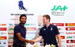 October 3, 2018 - Colombo, Sri Lanka - Sri Lankan cricket team captain Dinesh Chandimal (L) and England cricket captain Eoin Morgan shake hands during a press conference in Colombo,Sri Lanka, Wednesday, October 3, 2018. (Credit Image: © Pradeep Dambarage/Pacific Press via ZUMA Wire)