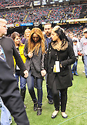 """Singer and actress Miley Cyrus holds tightly to her friends hand as she hangs her head and walks off the field before the Sainst beat the Rams 31-13. on the sideline before the kick off of the game against the St. Louis Rams. Miley Cyrus isin New Orleans to film her new movie in""""  So Undercover """" also staring Kelly Osbourne .hangs out on the Saints sidelines and poses with Saints owner Rita Benson Leblanc  prior to the kick off against the St. Louis Ram.The New Orleans Saints play the St. Louis rams in New Orleans at the Super Dome Sunday Dec. 12,2010. Tghhe Saints won 31-13 to go 10&3.Photo©SuziAltman. New Orleans, Louisiana, U.S. - Twilight Actor TAYLOR LAUTNER hangs out on the Saints sidelines prior to the kick off against the St. Louis Ram.The New Orleans Saints play the St. Louis rams in New Orleans at the Super Dome Sunday Dec. 12,2010. Saints went on to win 31-13..(Credit Image: © Suzi Singer and actress MILEY CYRUS poses for a fan's camera phone with New Orleans police officers on the sidelines prior to The New Orleans Saints' kickoff against the St. Louis Rams at the Superdome. Cyrus is currently filming ''So Undercover'' in New Orleans.Photo©Suzi Altman Twilight series ACTOR TAYLOR LAUTNER  wears a headset and listens as the plays are being called on the New Orleans Sainst sidelines during the game against the St. Louis Rams. LAUTNER and poses with Saints owner Rita Benson Leblanc  prior to the kick off against the St. Louis Ram.The New Orleans Saints play the St. Louis rams in New Orleans at the Super Dome Sunday Dec. 12,2010. Saints won 31-13.Photo©SuziAltman. New Orleans, Louisiana, U.S. - Twilight Actor TAYLOR LAUTNER hangs out on the Saints sidelines prior to the kick off against the St. Louis Ram.The New Orleans Saints play the St. Louis rams in New Orleans at the Super Dome Sunday Dec. 12,2010. Saints went on to win 31-13.Photo©Suzi Altman"""