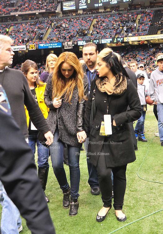 "Singer and actress Miley Cyrus holds tightly to her friends hand as she hangs her head and walks off the field before the Sainst beat the Rams 31-13. on the sideline before the kick off of the game against the St. Louis Rams. Miley Cyrus isin New Orleans to film her new movie in""  So Undercover "" also staring Kelly Osbourne .hangs out on the Saints sidelines and poses with Saints owner Rita Benson Leblanc  prior to the kick off against the St. Louis Ram.The New Orleans Saints play the St. Louis rams in New Orleans at the Super Dome Sunday Dec. 12,2010. Tghhe Saints won 31-13 to go 10&3.Photo©SuziAltman. New Orleans, Louisiana, U.S. - Twilight Actor TAYLOR LAUTNER hangs out on the Saints sidelines prior to the kick off against the St. Louis Ram.The New Orleans Saints play the St. Louis rams in New Orleans at the Super Dome Sunday Dec. 12,2010. Saints went on to win 31-13..(Credit Image: © Suzi Singer and actress MILEY CYRUS poses for a fan's camera phone with New Orleans police officers on the sidelines prior to The New Orleans Saints' kickoff against the St. Louis Rams at the Superdome. Cyrus is currently filming ''So Undercover'' in New Orleans.Photo©Suzi Altman Twilight series ACTOR TAYLOR LAUTNER  wears a headset and listens as the plays are being called on the New Orleans Sainst sidelines during the game against the St. Louis Rams. LAUTNER and poses with Saints owner Rita Benson Leblanc  prior to the kick off against the St. Louis Ram.The New Orleans Saints play the St. Louis rams in New Orleans at the Super Dome Sunday Dec. 12,2010. Saints won 31-13.Photo©SuziAltman. New Orleans, Louisiana, U.S. - Twilight Actor TAYLOR LAUTNER hangs out on the Saints sidelines prior to the kick off against the St. Louis Ram.The New Orleans Saints play the St. Louis rams in New Orleans at the Super Dome Sunday Dec. 12,2010. Saints went on to win 31-13.Photo©Suzi Altman"