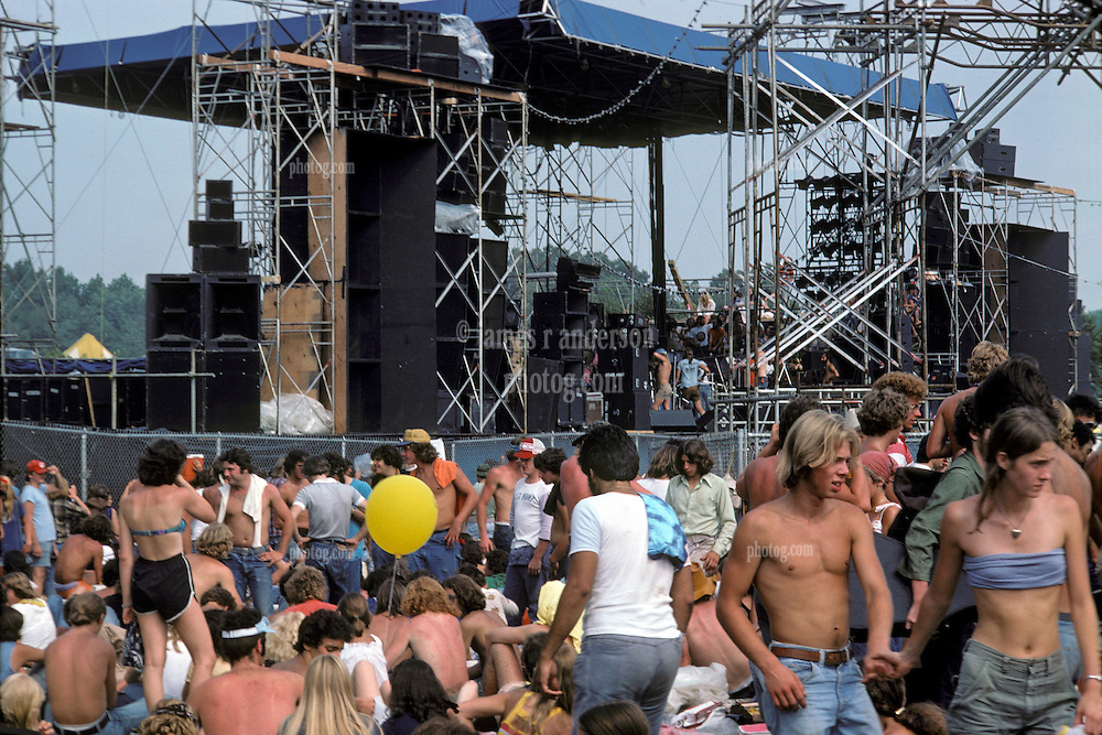 Scenes of the audience at the Labor Day Weekend Grateful Dead Concert, Englishtown NJ, 3 September 1977. The Stage in the distance and a Sound Relay Tower in the scene.