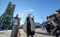 October 10, 2018 - Baikonur, Kazakhstan - Russian Orthodox priest, Father Sergei during the traditional blessing of the Soyuz spacecraft on the launch pad at the Baikonur Cosmodrome October 10, 2018 in Baikonur, Kazakhstan. International Space Station Expedition 57 crew Nick Hague of NASA and Alexey Ovchinin of Roscosmos are scheduled to launch on October 11th and will spend the next six months living and working aboard the International Space Station. (Credit Image: © Bill Ingalls via ZUMA Wire)