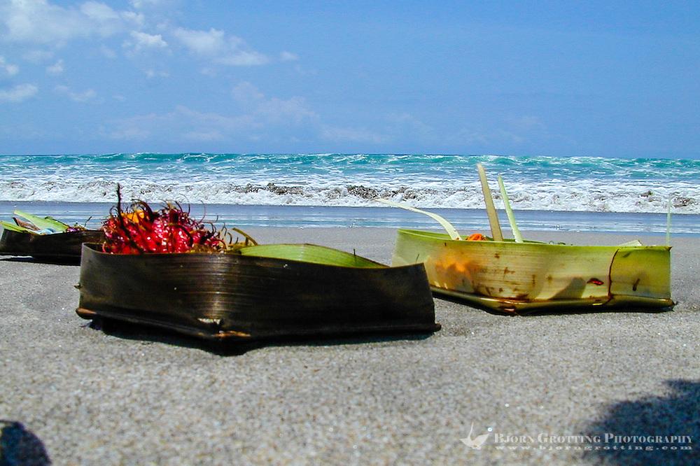 Bali, Badung, Kuta. Kuta Beach, small offerings to the gods.