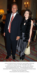 Actor CHRISTOPHER CAZENOVE and ISABEL DAVIS at a party in London on 5th April 2004.PTC 64