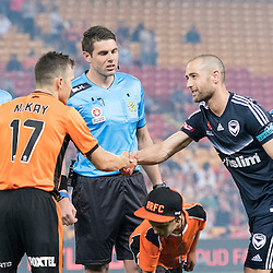 BRISBANE, AUSTRALIA - OCTOBER 7: Matt McKay of the Roar and Carl Valeri of the Victory shake hands during the round 1 Hyundai A-League match between the Brisbane Roar and Melbourne Victory at Suncorp Stadium on October 7, 2016 in Brisbane, Australia. (Photo by Patrick Kearney/Brisbane Roar)