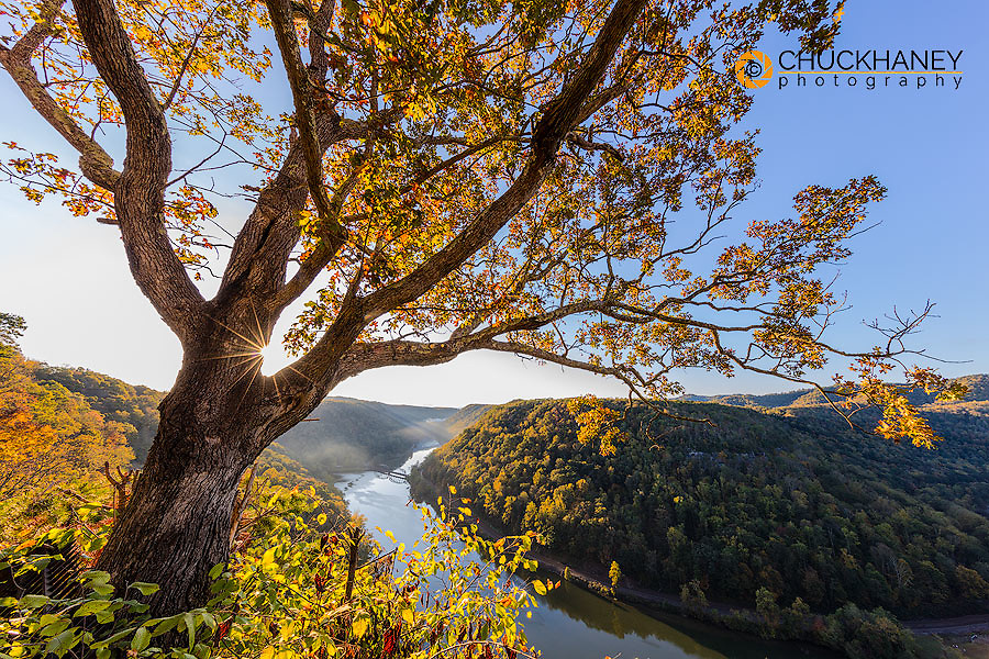 Sunrise light filters into the New River Gorge at Hawks Nest State Park in Ansted, West Virginia, USA