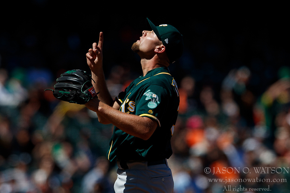 SAN FRANCISCO, CA - JULY 15: Blake Treinen #39 of the Oakland Athletics celebrates after the game against the San Francisco Giants at AT&T Park on July 15, 2018 in San Francisco, California. The Oakland Athletics defeated the San Francisco Giants 6-2. (Photo by Jason O. Watson/Getty Images) *** Local Caption *** Blake Treinen