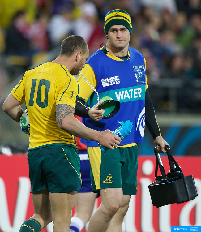 Australian captain James Horwill, who was rested for the match, acts as the teams water boy with Quade Cooper (left)  during the Australia V USA, Pool C match during the IRB Rugby World Cup tournament. Wellington Stadium, Wellington, New Zealand, 23rd September 2011. Photo Tim Clayton..