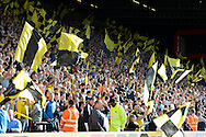 Watford fans celebrate with waving flags after the final whistle as Watford celebrate there first win of the 2015/16 season. Barclays Premier League, Watford v Swansea city at Vicarage Road in London on Saturday 12th September 2015.<br /> pic by John Patrick Fletcher, Andrew Orchard sports photography.