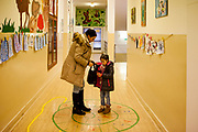 Daniela Kroscenova (27) with her daughter Esther Kroscenova (6)  in the hall way of ZS Chrustova elementary school after an enrollment examination (test). Esther should be a first class pupil in the school year 2016/2017 in a mainstream school in the city of Ostrava, where Roma and non Roma children are educated together.