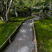 """Hogon-in """"garden of the lion's roar"""" was created by a zen priest in the Muromachi period.  Hogon-in is a sub-temple of Tenryu-ji temple and was built in 1461 in Kamigyo ward. It burnt down during the Onin War and was rebuilt later. In the Meiji period, it was moved to its present location in Arashiyama.  Its shishiku garden  was designed by Sakugen Shuryo and its highlight is a giant rock, said to shaped like a lion, a smaller stone symbolizes a carp jumping against the water of a waterfall."""