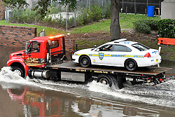 Police vehicle is removed from a flooded garage as flood water resides from parts of Jacksonville, FL after Hurricane Irma took an unexpected turn and caused massive power outages and coastal flooding around the state, on September 11, 2017.