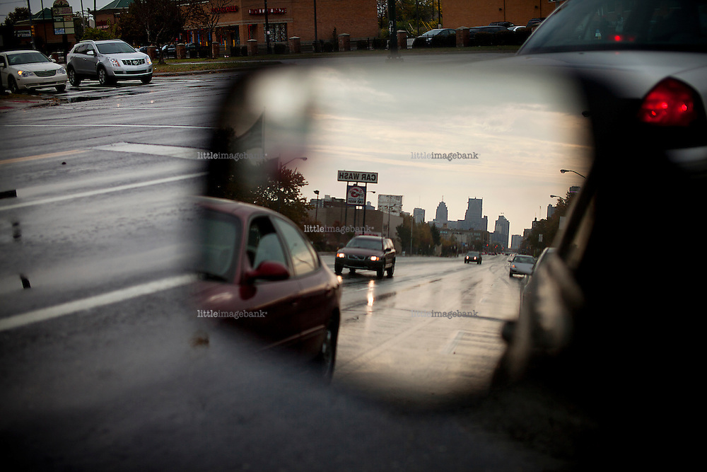 Detroit, Michigan, USA. Jeffersom avenue seen through a rearview mirror of an automobile. The state of Michigan once was concidered a promised land, in the era of the american automobile industry adventure. Due to the financial crisis, the state is on the brink of economic and social colapse. Fifty years ago, the city of Detroit was home of two million residents. In 2012 only 700.000 residents remain, and 87 percent of the remaining residents are African Americans. The gap between rich and poor in Detroit are as great as in the Philipines. Photo: Christopher Olssøn.