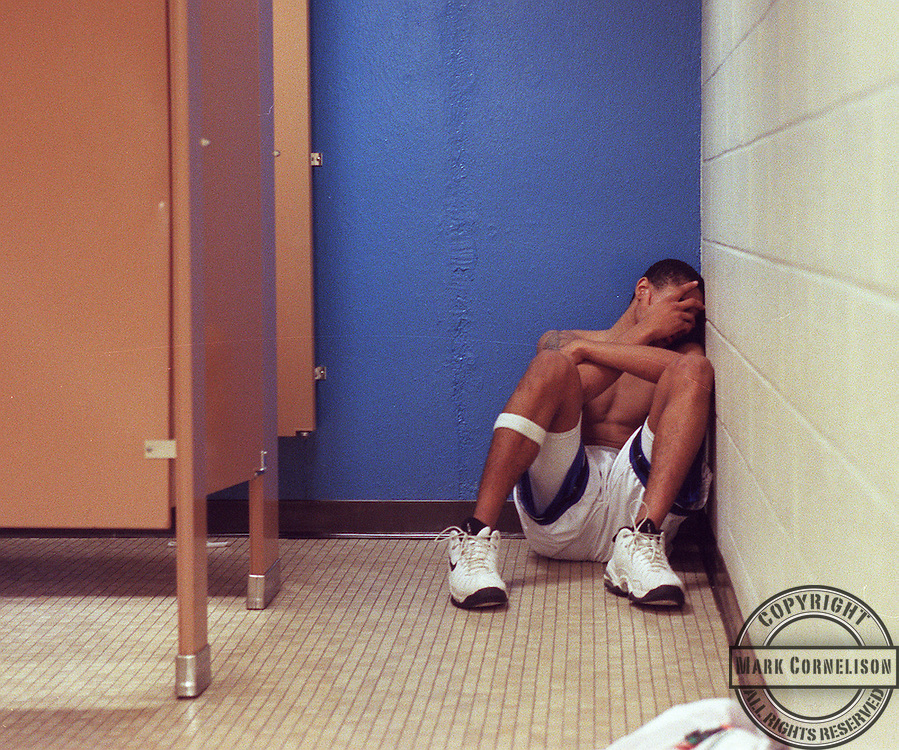 Lexington Catholic senior forward Steve Searcy sat in a corner  by himself as he tried to deal with the last second loss to Scott County in the  at the Sweet 16  final four on saturday March 21,1998 in Lexington Ky.