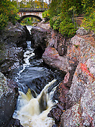 The Temperance River cuts a gorge through soft lava and enters Lake Superior within Temperance River State Park just north of Schroeder, near Tofte, Cook County, in northern Minnesota, USA. The State Highway 61 bridge crosses the river next to the campground.