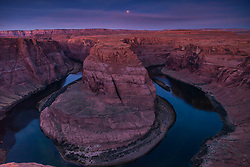 Blue Moon Eclipse, Horseshoe Bend, Page Arizona. Once in a blue moon is a metaphor for rare events.  Blue moons aren't really blue, they are merely a second blue moon of a calendar month. As we know moon eclipses are even rarer than blue moons, here we have an eclipsing blue moon. <br /> <br /> Rare enough I drove 500 miles to capture this on as the weather at my home would not provide a window to the moon.