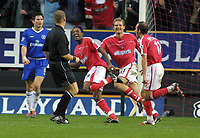 Jason Euell (Charlton) celebrates his goal with Paolo Di Canio and Jonatan Johansson. Frank Lampard (Chelsea) looks on. Charlton Athletic v Chelsea. 26/12/2003. Credit : Colorsport/Andrew Cowie.
