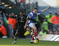 Photo: Lee Earle.<br /> Portsmouth v Charlton Athletic. The Barclays Premiership. 20/01/2007. Pompey's Matthew Taylor (R) battles with Osei Sankofa.