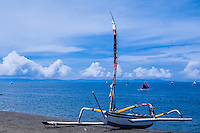 Nusa Tenggara, Lombok, Senggigi. Traditional sail vessels, Bali in the background.