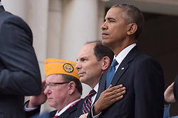 November 11, 2016 - Arlington, United States of America - U.S. President Barack Obama stands for the national anthem during Veterans Day at the Memorial Amphitheater in Arlington National Cemetery November 11, 2016 in Arlington, Virginia. (Credit Image: © Sgt. Cody W. Torkelson/Planet Pix via ZUMA Wire)