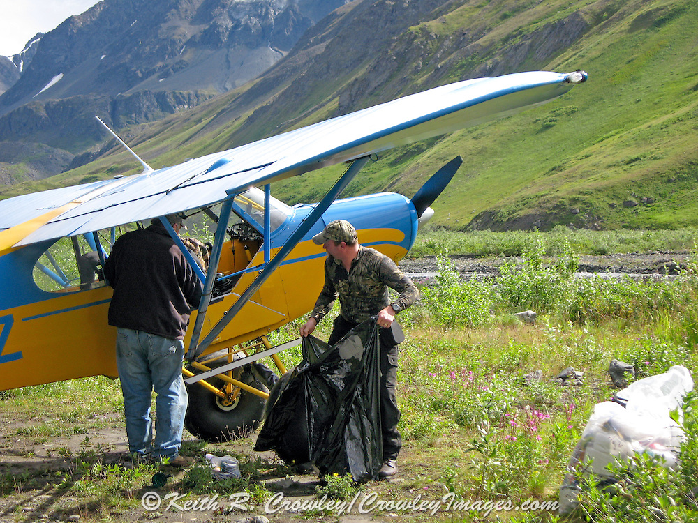 Dave Crowley (r) loading a Super Cub Airplane during a Dall Sheep in the Chugach Mountains of Alaska