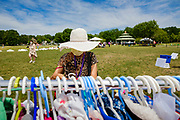 """19 JULY 2020 - DES MOINES, IOWA: A woman looks at children's clothing during """"A Celebration of Black Motherhood"""" in Des Moines Sunday. The event was organized by the Supply Hive and Black Lives Matter. Items were donated by members of the community and redistributed to at risk families. They distributed diapers, sanitary products, clothes, books, and toys. They had enough material to help 200 families.        PHOTO BY JACK KURTZ"""