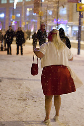 """© under license to London News Pictures. 18/12/2010 as snow blizzards hit Manchester revellers continue their """"Mad Friday"""" night out. Despite the conditions, some were determined to continue an normal"""