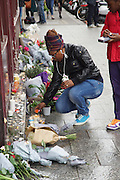 Lighting candles. Le Carillon, Corner of Rue Bichat and Rue Aubert<br />