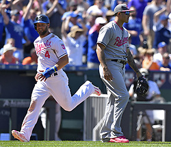 May 14, 2017 - Kansas City, MO, USA - Kansas City Royals' Alex Gordon heads for home as Baltimore Orioles third baseman Manny Machado watches his throwing error to second, allowing Alcides Escobar to reach second on a bunt in the fifth inning on Sunday, May 14, 2017 at Kauffman Stadium in Kansas City, Mo. (Credit Image: © John Sleezer/TNS via ZUMA Wire)