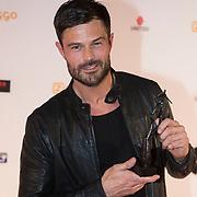 NLD/Amsterdam/20140303 - Uitreiking TV Beelden 2014, Arie Boomsma met zijn award
